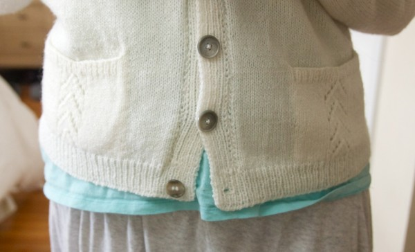 buttons on the cardigan